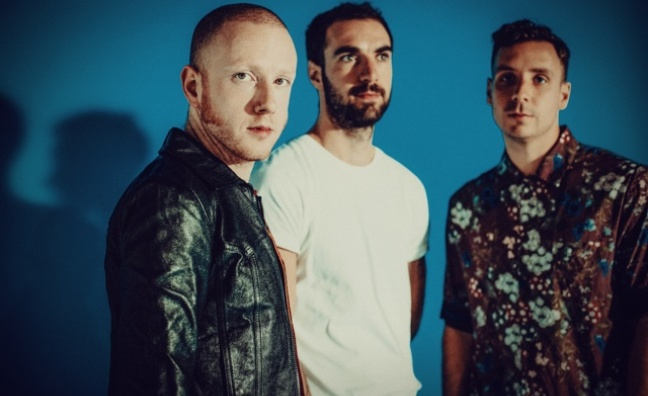 'There are a lot of positive signs for guitar bands': Two Door Cinema Club talk False Alarm and Glastonbury