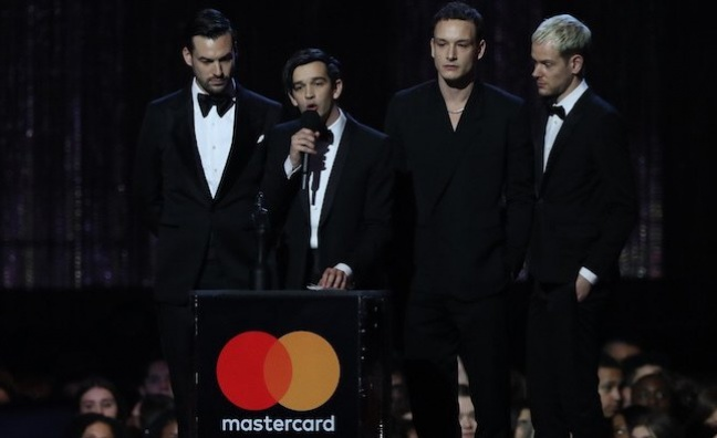 The 1975, Calvin Harris win big at slick BRITs show
