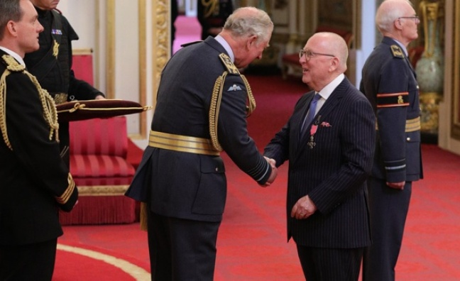 UTA's Neil Warnock receives MBE at Buckingham Palace